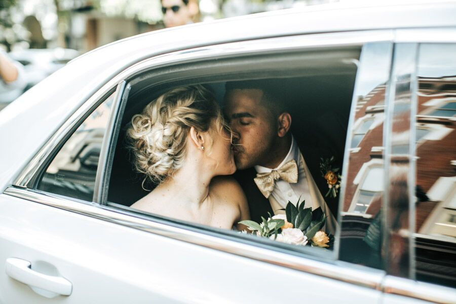 Bride & Groom in Wedding Limo