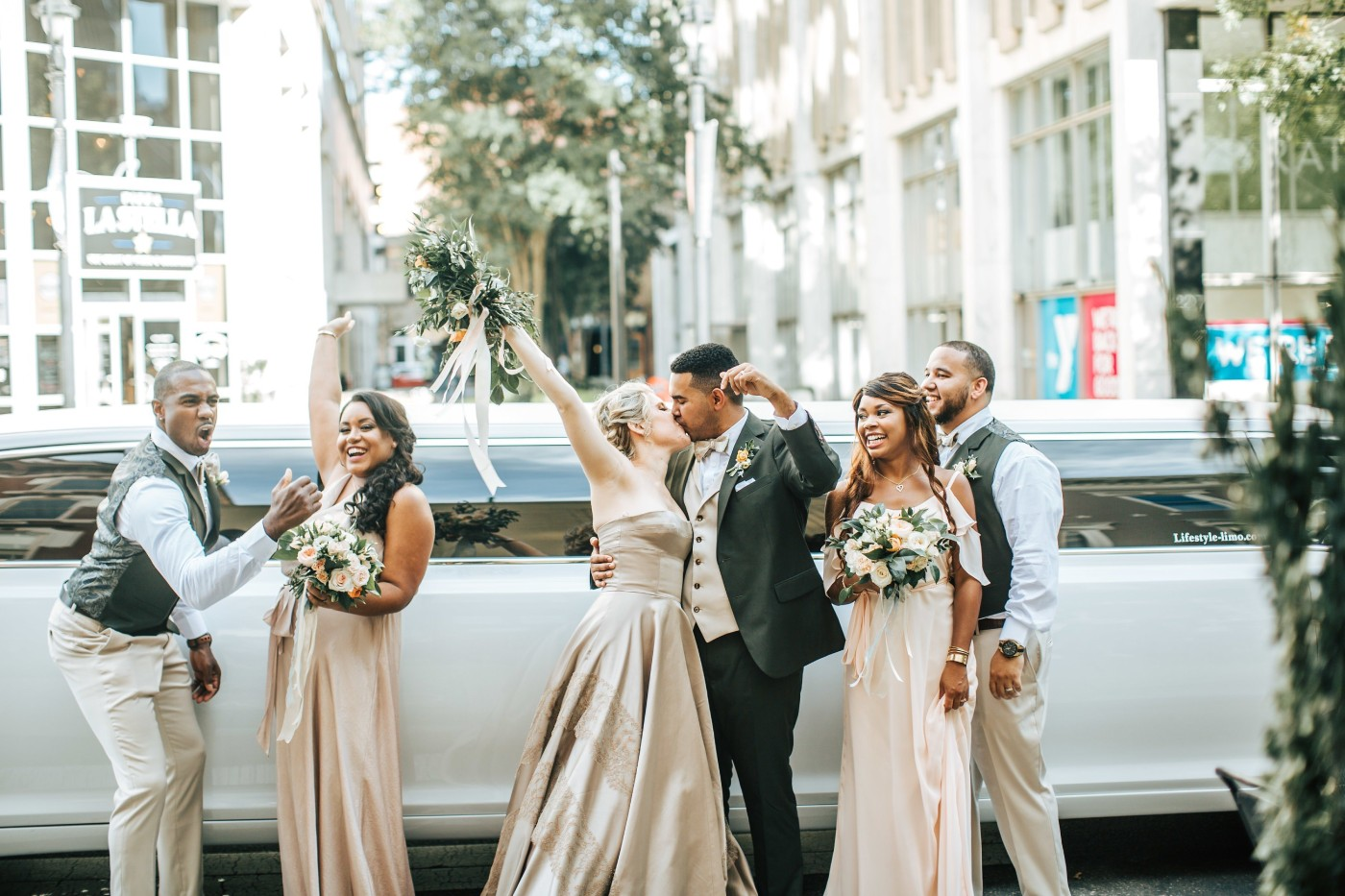 Wedding Party in Front of Limo